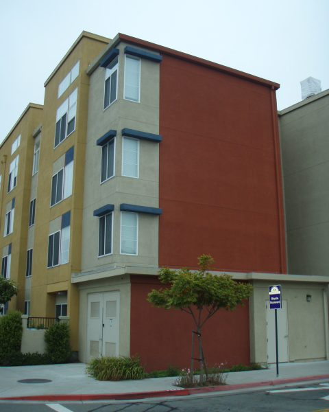 A red, grey, and yellow building